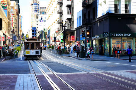 streetlife: San Fransisco , CA, USA - September 28, 2013: Old tram - It is the most popular way to get around the city of San Fransisco which is in service since 1873.