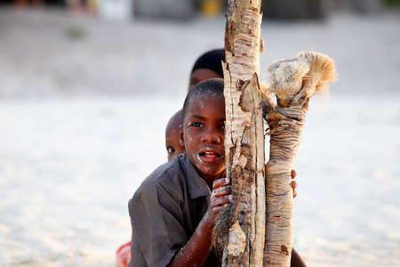 10 11 years: Zanzibar, Tanzania - January 9, 2016: Three African children playing hide and seek on the beach on Zanzibar
