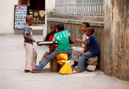 8 10 years: Zanzibar, Tanzania - January 10, 2016: East Africa, unknown dark skinned children, about 8 years old, playing outdoor, in Stone Town, Zanzibar.