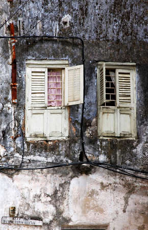 old windows: Old wooden windows at Stone Town the capital of Zanzibar island East Africa. Stock Photo