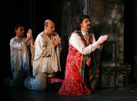 a courtesy: Russia, Moscow - April 11, 2007: Russian actors Igor Zolotovitsky, Leonid Barats and Rostislav Hait in performance Is faster than rabbits in Moscow, Russia