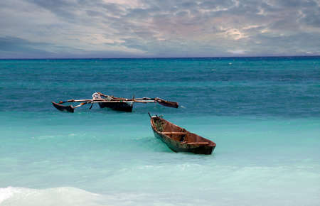 sea fishing: Traditional fishing boats in ocean. Zanzibar Stock Photo