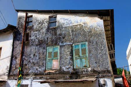 east africa: Old wooden windows at Stone Town the capital of Zanzibar island East Africa. Zanzibar Stock Photo