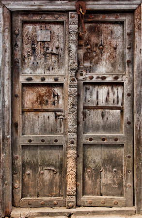 east africa: Old wooden door at Stone Town the capital of Zanzibar island East Africa. Zanzibar
