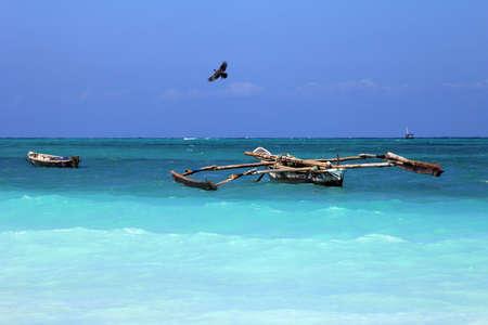 ocean fishing: Traditional fishing boats in ocean. Zanzibar Stock Photo