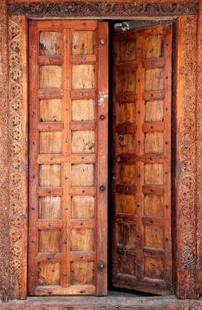 arabic  style: Old wooden door at Stone Town the capital of Zanzibar island East Africa. Zanzibar