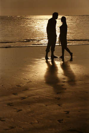 Couple on sunset. Coast of the Indian ocean photo