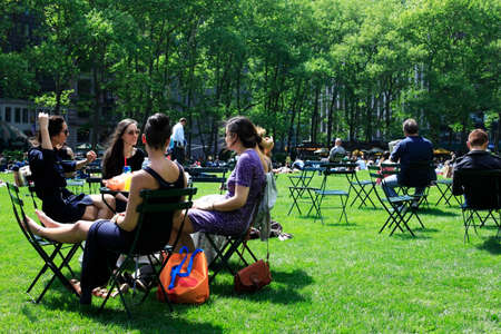 bryant: York City, NY, USA - May 16, 2013: People enjoying a nice day in Bryant Park on May 16, 2013 in New York City, NY. Bryant Park is a 9,603 acre privately managed park in the center of Manhattan.