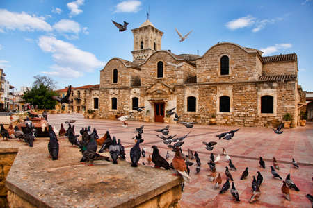 lazarus: Birds flying outside of the Ancient 9th century Greek Orthodox Church of Ayios Lazarus in Larnaca, southern Cyprus. Known as Church of Saint Lazarus.