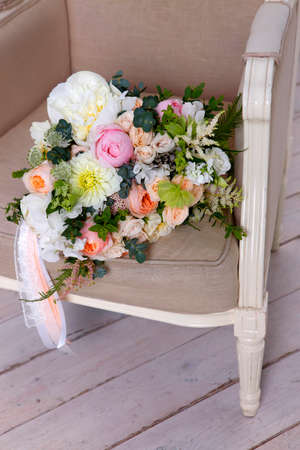 vintage chair: Beautiful wedding bouquet, forgotten on a vintage chair Stock Photo