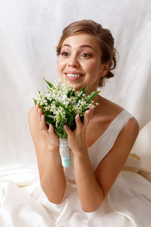 debutante: The beautiful bride with bouquet