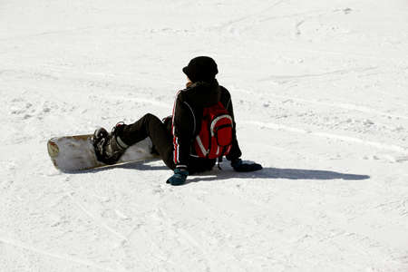 siervo: Snowboarder siting on fresh powder snow