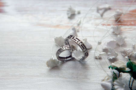 satiny: Wedding rings on a satiny fabric