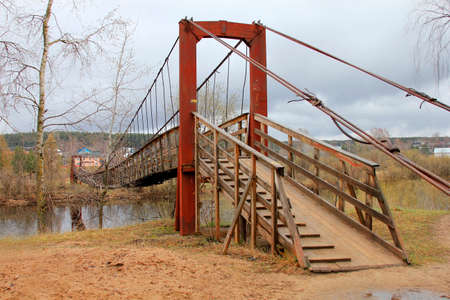 backwoods: Suspension bridge across the Volga River in the village of Verkhovazhye Vologda region. Russia