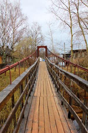 lift gate: Suspension bridge across the Volga River in the village of Verkhovazhye Vologda region. Russia