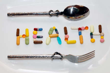inlaid: Word health inlaid with colored pills Stock Photo