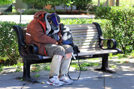San Francisco, CA, USA - September 26, 2013: Homeless man sleeps on the street in the center of San Francisco Editorial