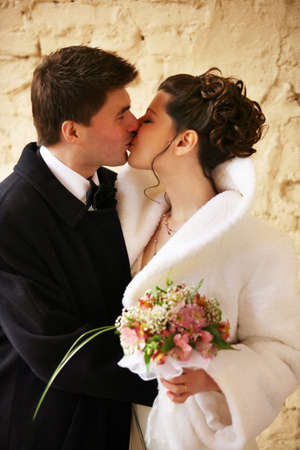 Beautiful the bride and the groom kiss Stock Photo
