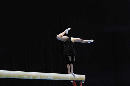 balance beam: Gymnast performs an exercise on the balance beam