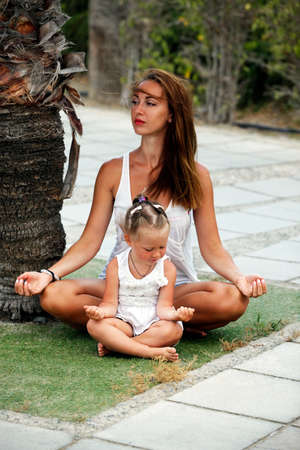 douther: Mum with a small daughter do yoga