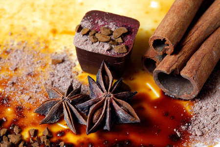 anice: Chocolate candy isolated with anice and cinnamon Stock Photo