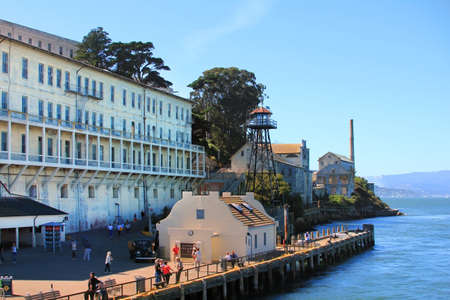alcatraz: San Francisco, California, USA - September 28, 2011: These men and women and children are enjoying the views of what was Alcatraz Prison now a National Park in San Francisco Bay California, located in the bay and accessable only by the licensed boat compa