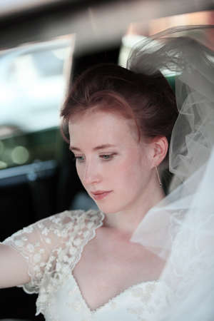 Beautiful the bride in car photo