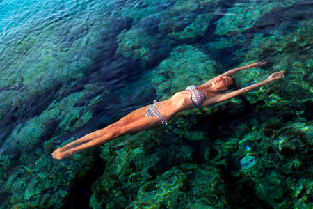 Woman Floating in Water Relaxing photo