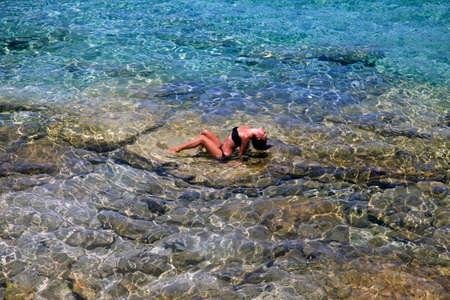 Beautiful girl in the transparent mediterranean sea. Cyprus photo