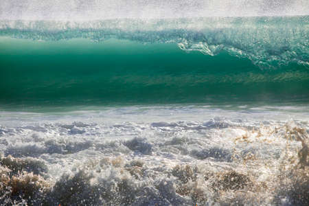Big wave crashes on to the shore Stock Photo