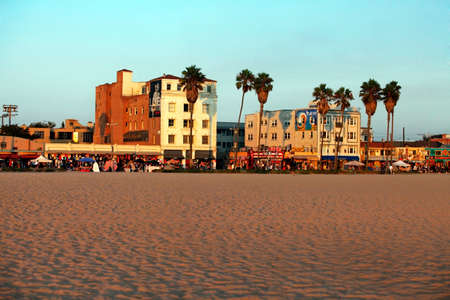 Venice, California, USA - September 18, 2011: People crossing the street at the intersection of Winward and Pacific Avenue, with the famous VENICE sign near Venice Beach - a popular touristic attraction in Southern Californa. Stock Photo