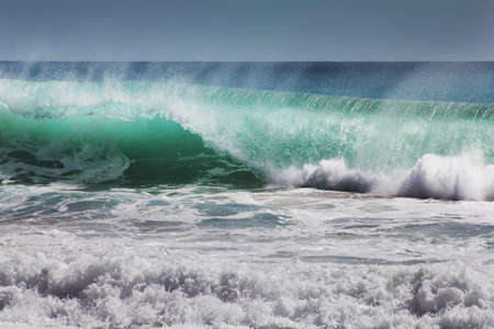 Big wave crashes on to the shore. Indian ocean