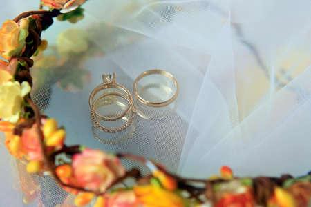 Wedding rings on a blue satiny fabric Reklamní fotografie