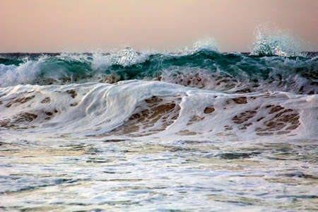 Wave crashes on to the shore. Caribian sea