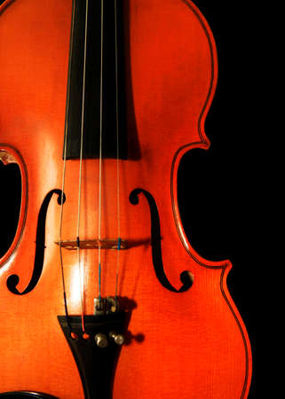 1937 old violin on the black background 写真素材