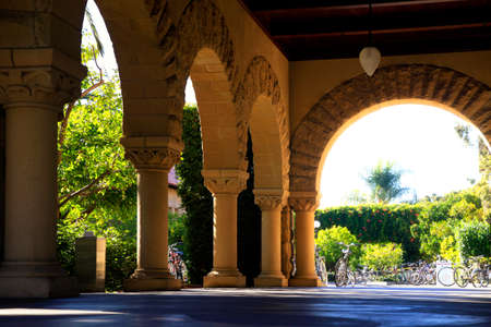 Long corridor at Stanford California. Amber sculpted stones columns Editorial