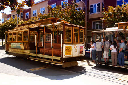 SAN FRANCISCO, CA, USA - AUGUST 17, 2013: Passengers ride in a cable car on August 17, 2013 in San Francisco. It is the most popular way to get around the City of San Fransisco which is in service since 1873. Éditoriale