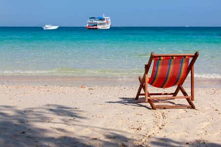 Wooden beach chair on a beautiful ocean shore