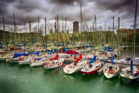 Tall luxury boats and yachts moored in duquesa Port In Spain. Barcelona