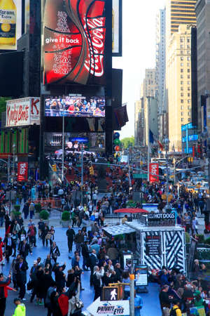 New York, NY, USA - May 16, 2013: Times Square, featured with Broadway Theaters and huge number of LED signs, is a symbol of New York City and the United States, May 16, 2013 in Manhattan, New York City Editorial