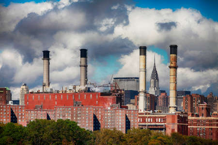 Factory pipes on a sky background, New York City Standard-Bild