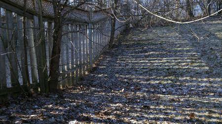 Sunlight filtering through fence slats 版權商用圖片