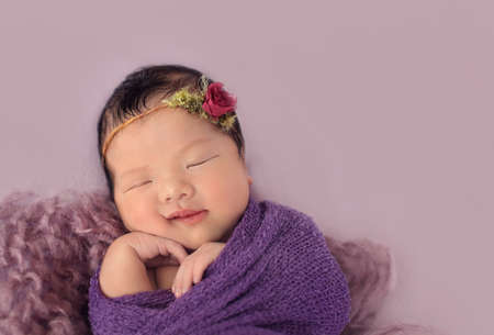 wrapped up: Cute sleeping asian baby wrapped up in towel and soft wool Stock Photo