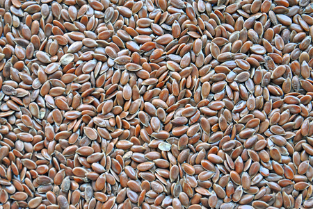 flaxseed: linseed flaxseed spread out as backround Stock Photo