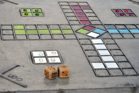 ludo: ludo board game made out of concrete played with dice