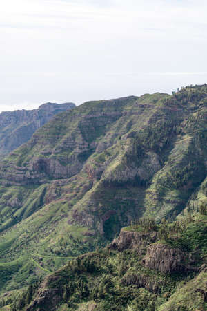 depending: mirador de tajaque, gomera island, spain. Gomera is one of the most attractive canary islands, depending to spain. It is a vulcan island. you can reach gomera by taking the ferry from teneriffa. No international flights arrive here. Stock Photo