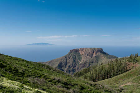 depending: Fortaleza de Chipude, prominent mountain, gomera, canary island, spain. Gomera is one of the most attractive canary islands, depending to spain. It is a vulcan island. you can reach gomera by taking the ferry from teneriffa. No international flights arriv