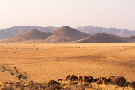 avid: Scenery on the travel from namib naukluft park to tiras mountains. Travelling on gravel and sand roads. Stock Photo