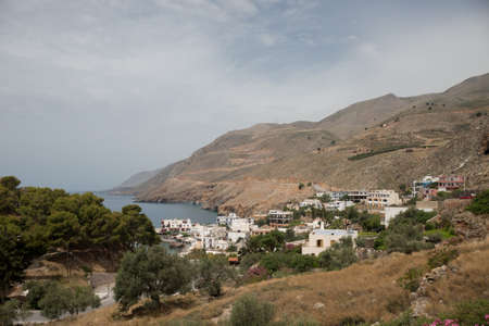 kreta: GREECE, CHORA SFAKION - MAY, 20. 2016: View on the town and the harbour of Chora Sfakion (Illustrative Editorial) Editorial