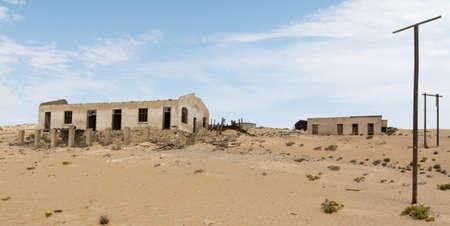 vanished: NAMIBIA, KOLMANSKOP - SEPTEMBER, 14. 2014: Ghost Town Kolmanskop, former Diamond Dagger Town in desert stripe near Luederitz. It was used from 1908 till 1930. Now its abandoned and desertificated.